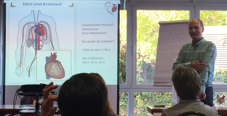 Vortrag von Dr. Dürsch bei einer Präsenzveranstaltung